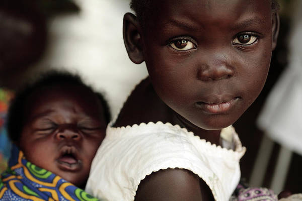 Uganda Wall Art - Photograph - Ugandan Girl Carrying A Baby by Mauro Fermariello/science Photo Library