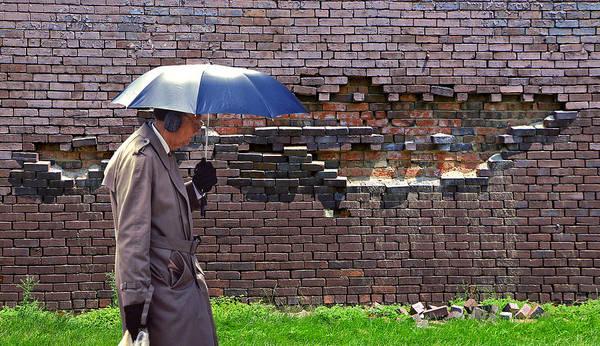 Ear Muffs Photograph - Umbrella Man And Brick Wall by Christopher McKenzie
