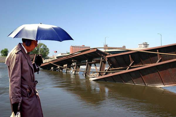Ear Muffs Photograph - Umbrella Man And Bridge Collapse by Christopher McKenzie