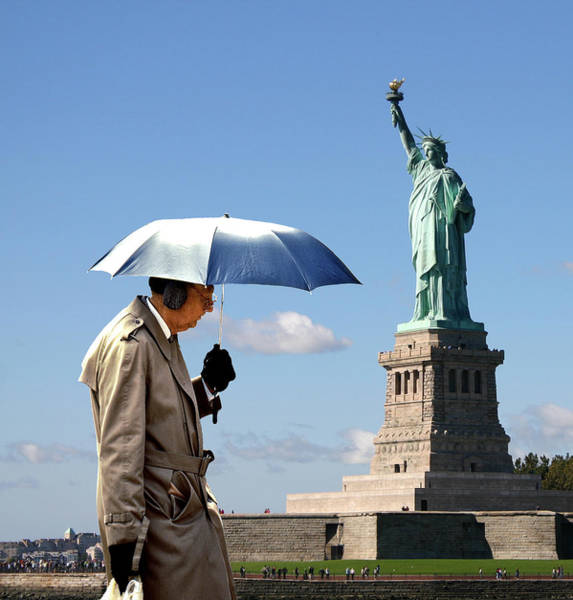 Ear Muffs Photograph - Umbrella Man And Lady Liberty by Christopher McKenzie
