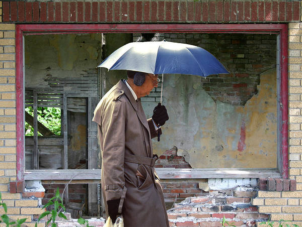 Ear Muffs Photograph - Umbrella Man And Old Station by Christopher McKenzie