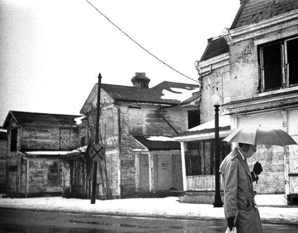 Ear Muffs Photograph - Umbrella Man And Vacant Buildings by Christopher McKenzie