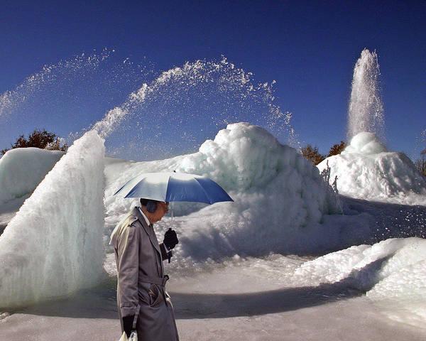 Ear Muffs Photograph - Umbrella Man At Frozen Fountain by Christopher McKenzie