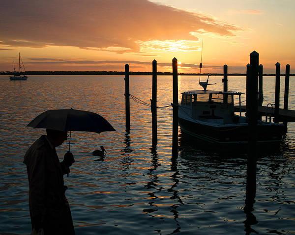 Ear Muffs Photograph - Umbrella Man At Sunset by Christopher McKenzie