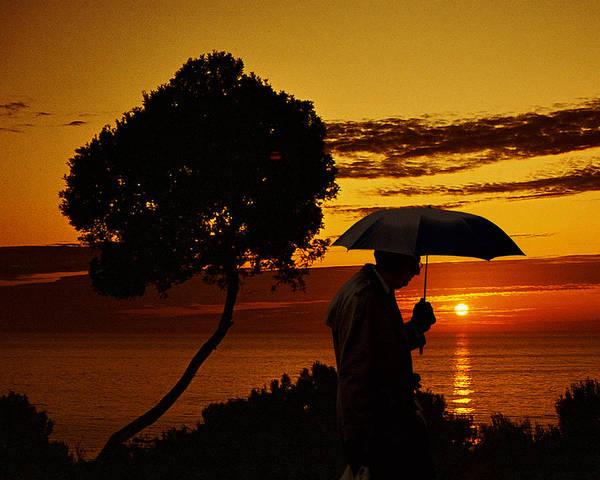 Ear Muffs Photograph - Umbrella Man At West Coast Sunset by Christopher McKenzie