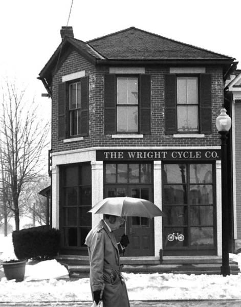 Ear Muffs Photograph - Umbrella Man In Dayton by Christopher McKenzie