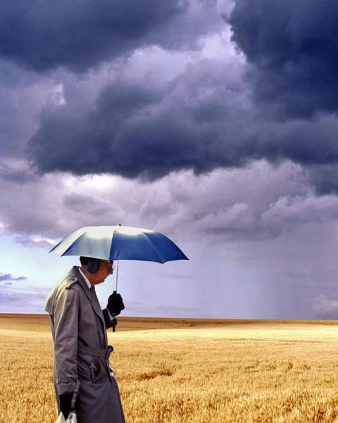 Ear Muffs Photograph - Umbrella Man In Kansas Wheat Field by Christopher McKenzie