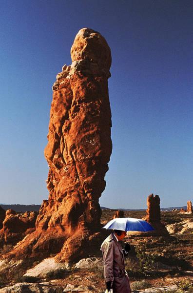 Ear Muffs Photograph - Umbrella Man In The Desert by Christopher McKenzie