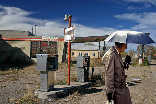 Ear Muffs Photograph - Umbrella Man In Vaughn by Christopher McKenzie
