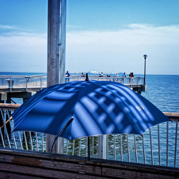 Photograph - Umbrella On Coney Island Pier by Frank Winters