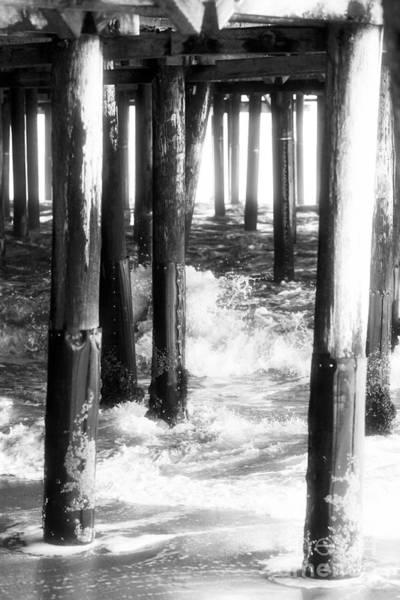 Under The Pier Photograph - Under The Santa Monica Pier by John Rizzuto