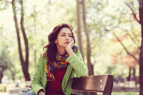 Unhappy Girl Sitting At Bench Art Print by Martin Dimitrov