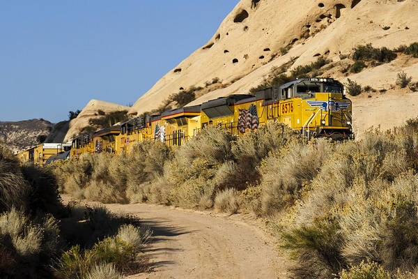 Photograph - Union Pacific Rolling Through The Mormon Rocks by Jim Moss