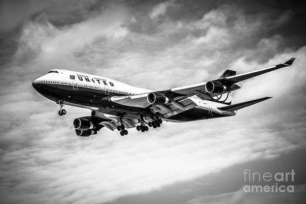Editorial Photograph - United Airlines Airplane In Black And White by Paul Velgos