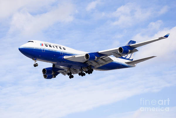 Editorial Photograph - United Airlines Boeing 747 Airplane Flying by Paul Velgos