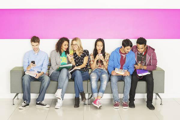 University Students Sitting On Bench Art Print by Robert Daly