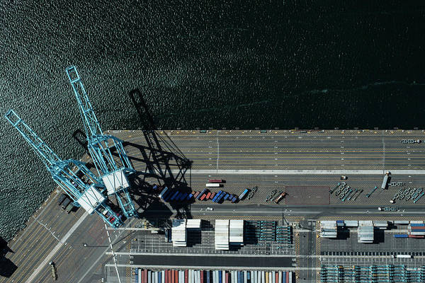 Compartments Photograph - Urban Landscape With River And Industry by Michael H