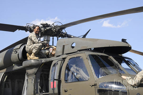 Utility Aircraft Photograph - U.s. Army Pilot Conducts Pre-flight by Stocktrek Images