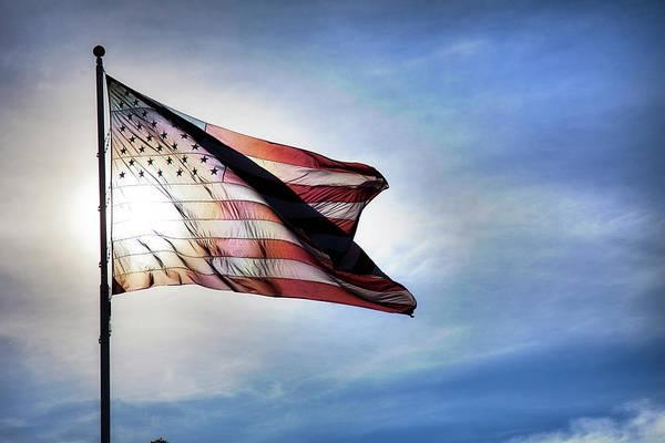 Usa Flag Photograph - Us Flag Fluttering In Backlit Blue Sky by Strickke