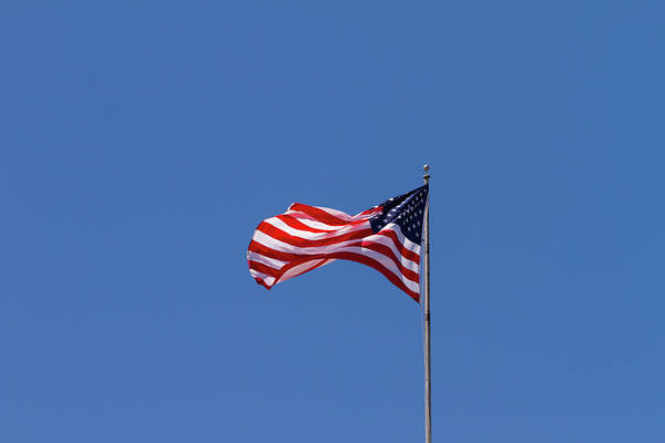 Usa Flag Photograph - Us Flag Flying From Flag Pole by P A Thompson