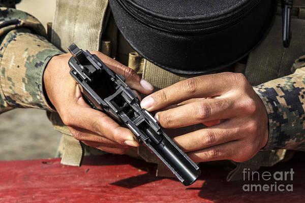 Beretta Photograph - U.s. Marine Assembles The M9 Pistol by Stocktrek Images