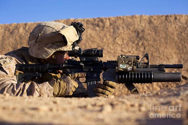 Gunfire Photograph - U.s. Marine Scans For Threats by Stocktrek Images