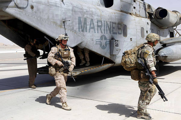 Ch Wall Art - Photograph - U.s. Marines And British Soldiers Exit by Stocktrek Images