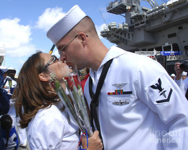 Uss Carl Vinson Photograph - U.s. Navy Sailor Kisses His Wife by Stocktrek Images