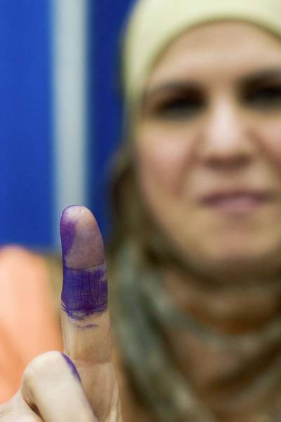 Poll Photograph - Us-resident Iraqi Votes In Iraq Election by Jim West