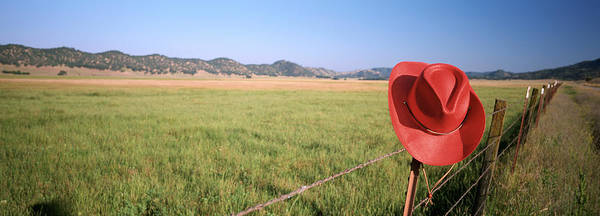 Wall Art - Photograph - Usa, California, Red Cowboy Hat Hanging by Panoramic Images
