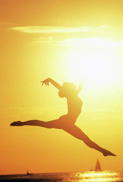 Agile Photograph - Usa, Hawaii Woman Jumping In Mid Air by Sunstar