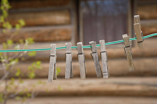 Clothesline Photograph - Usa, Montana Clothes Pins by Jaynes Gallery