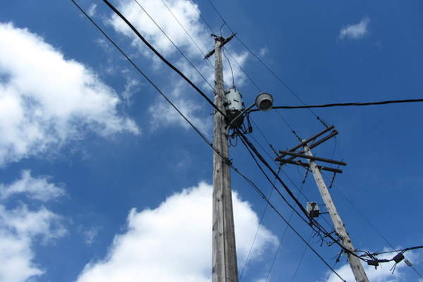 Photograph - Utility Poles And Clouds 11 by Anita Burgermeister