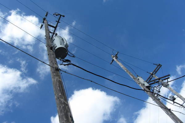Utility Pole Photograph - Utility Poles And Clouds 3 by Anita Burgermeister