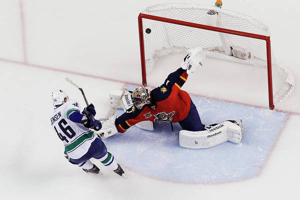 Scoring Photograph - Vancouver Canucks V Florida Panthers by Joel Auerbach