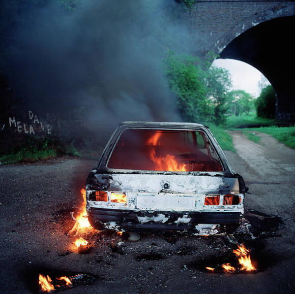 Wall Art - Photograph - Vandalized Car On Fire by Robert Brook/science Photo Library