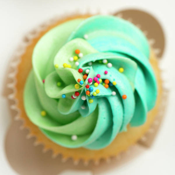 Sprinkles Photograph - Vanilla Cupcake With Frosting And by Anshu Ajitsaria