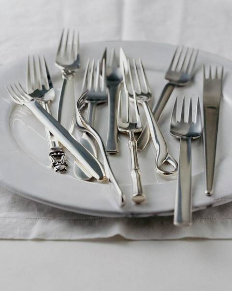 Cutlery Photograph - Various Forks On A Plate by Romulo Yanes