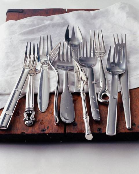 Cutlery Photograph - Various Forks On A Wooden Board by Romulo Yanes