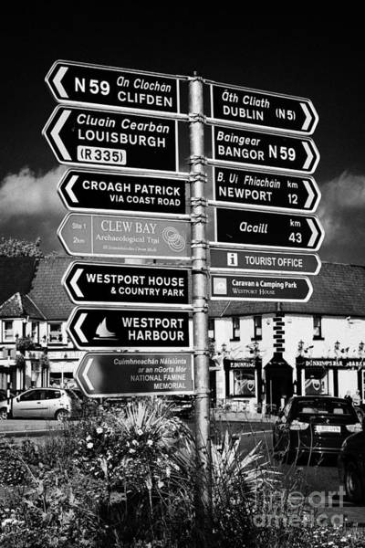 Wall Art - Photograph - Various Road Direction Signs In Westport County Mayo Republic Of Ireland by Joe Fox