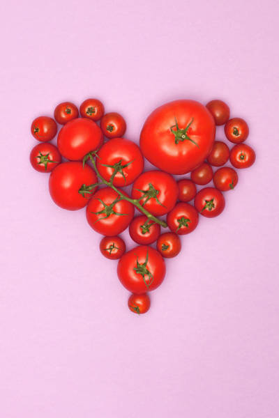 Styling Photograph - Various Sizes Of Tomatoes Arranged Into by Larry Washburn
