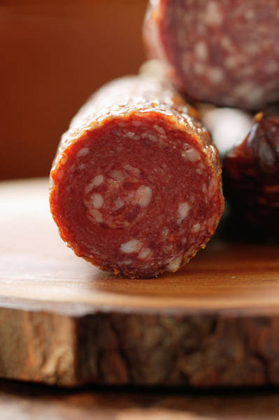 Wall Art - Photograph - Various Venison Sausages On Wooden Plate by Foodcollection