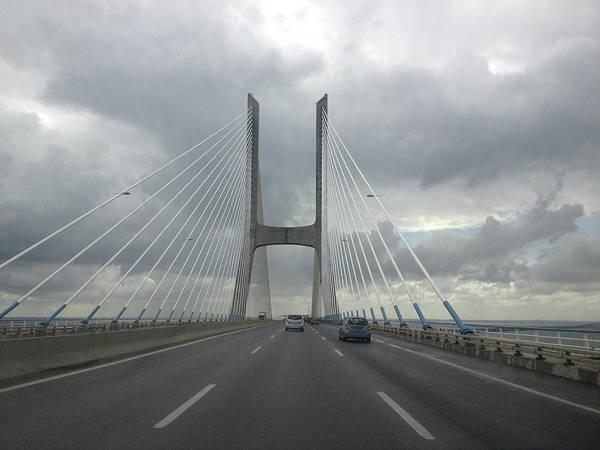 Vasco Da Gama Bridge Wall Art - Photograph - Vasco Da Gama Bridge In Lisboa by Nphotos