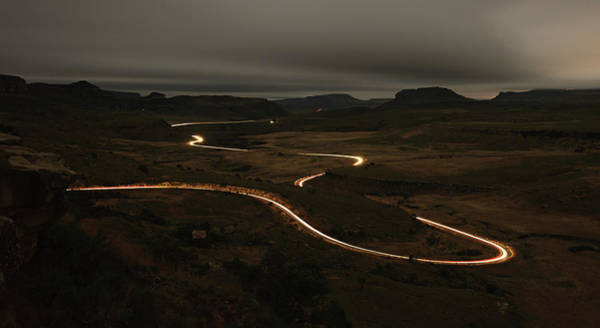 Highland Scenic Highway Wall Art - Photograph - Vehicle Light Trails Along The Road At by Emil Von Maltitz
