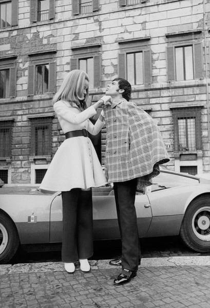 Urban Scene Photograph - Veruschka And Tomas Milian by Franco Rubartelli