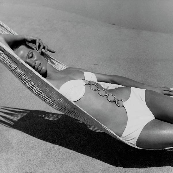 Linked Photograph - Veruschka Von Lehndorff Lying In A Hammock by Franco Rubartelli