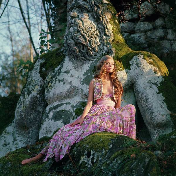 Floral Photograph - Veruschka Von Lehndorff Sitting On A Sculpture by Franco Rubartelli