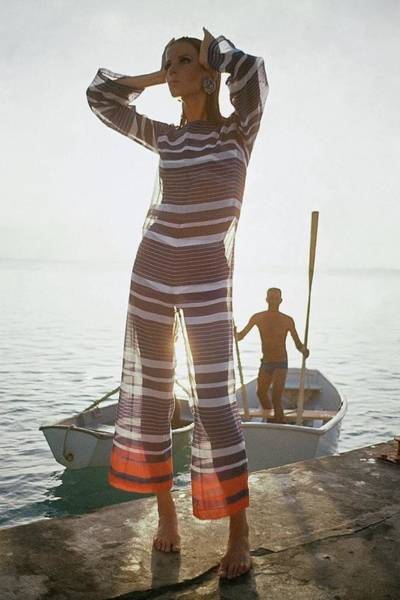 Water Photograph - Veruschka Von Lehndorff Wearing Jumpsuit by Louis Faurer