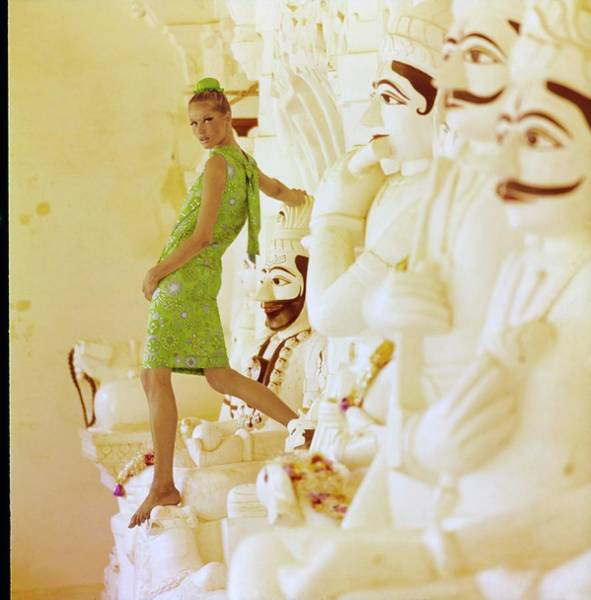 Buns Photograph - Veruschka Wearing A Junior Sophisticates Dress by Henry Clarke