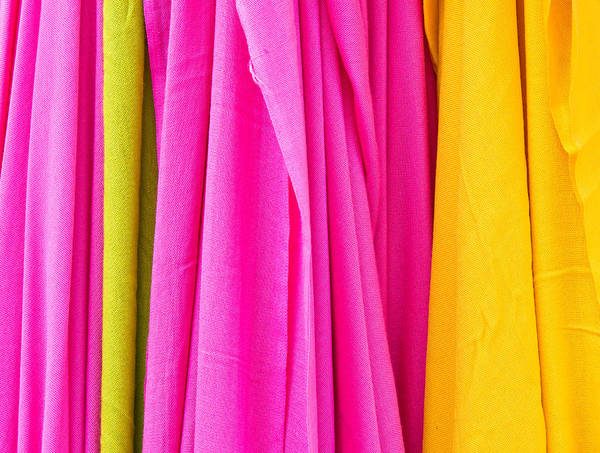 Clothing Store Photograph - Vibrant Cloths  by Tom Gowanlock